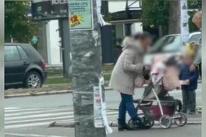 ŠOKANTAN SNIMAK Žena histerično šamara bebu u kolicima (VIDEO)